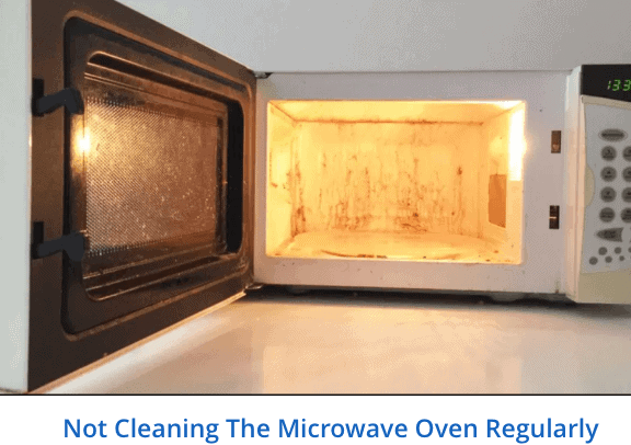 Not cleaning the microwave oven regularly